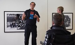 DisArt Director Christopher Smit listens to Tom Olin and Lisa VanArragon during a gallery talk at (106) Gallery