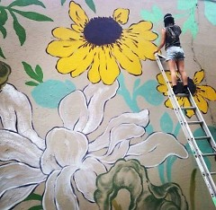 Artist Louise 'Ouizi' Chen painting the new mural on the Grand Rapids Ballet Company's building.