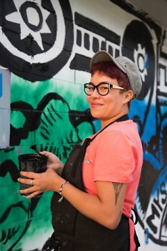 Kimberly Lavon working on her mural in the Baxter neighborhood