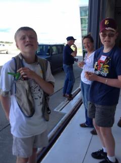 Noah, Heidi, and Nate Pamerleau await their flight.
