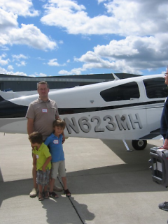 Aidan Jerema, right, with his brother Eli and their father, Marc.