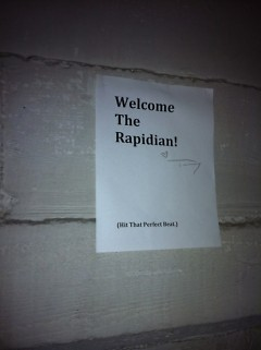 Tommy Allen provided a heartfelt welcome to the Rapidian art beat with a sign in the stairwell