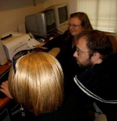 Preston works on computer projects with Well House staff members.