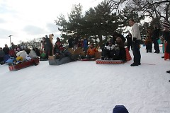 WinterWest participants busy assembling their cardboard sled contraptions.