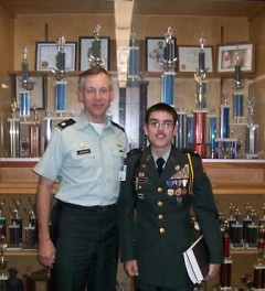 LTC Ron Janowski (Instructor) with cadet LTC Anthony Alcantar pictured in front of some of the program's many trophies