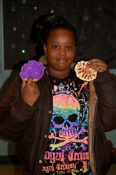 Seidman Club member Pareiah Buggs displaying two of her ceramic pieces in the exhibit.