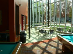 The sun streaming into the games room in the Steil Club on Straight Ave. NW