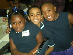 Club members enjoying a Thanksgiving dinner with Boys & Girls Clubs.