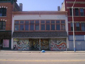 This picture was taken of 217 S. Division two months before Mr. Erkfitz created the mural. The spot is uninhabited at the moment