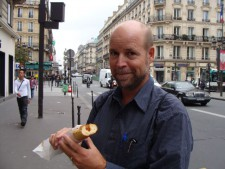 Runner Tim Penning enjoys a hot dog (in a baguette) in Paris.